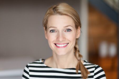 Close up Of A Smiling Caucasien blond woman in the living room