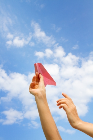 hand with a paper airplane. photo