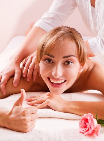 Beauty spa treatment  Smiling young women with thumb up Stock Photo - 14994709
