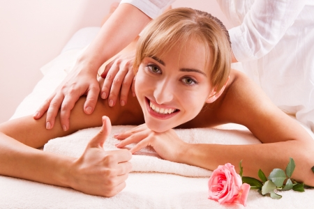 Massage Beauty spa treatment  Smiling young women with thumb up Stock Photo - 14994710