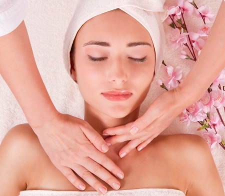 beauty salon face: young women in spa  Massage  young woman with closed eyes  macro