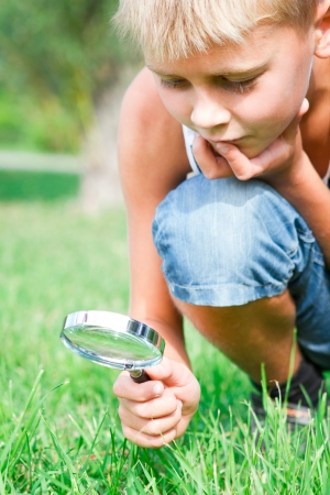 iquest: inquisitive boy with a lens in the park