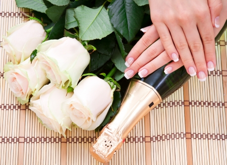 French manicure, white roses and champagne Stock Photo - 15548043