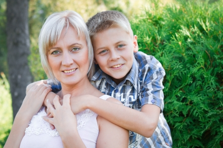 family relationships: Love between mother and her son. Nature background.