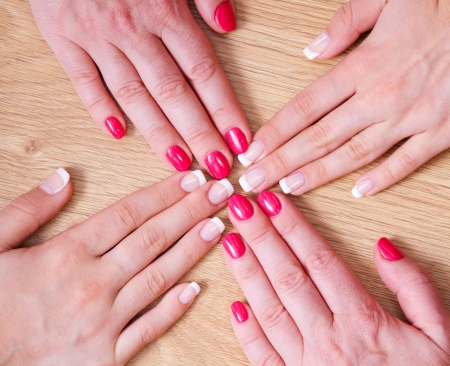 French manicure and red manicure Stock Photo - 15708275