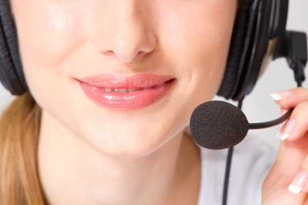 Smiling pretty business woman with headset    photo