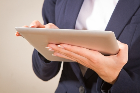 l woman working on a Person Using Modern Tablet Device  Stock Photo