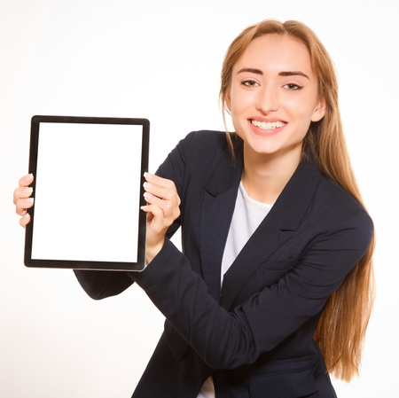 Young woman showing a tablet PC  photo