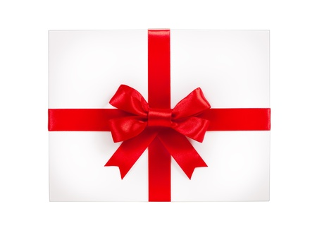 White gift box with red ribbon bow, isolated on white Stock Photo