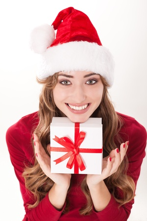 christmas woman with gift and red manicure photo