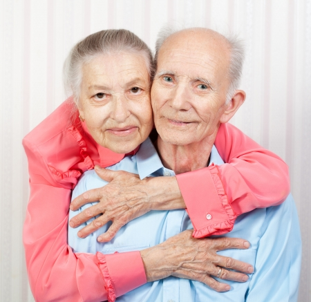 Closeup portrait of a smiling elderly couple photo