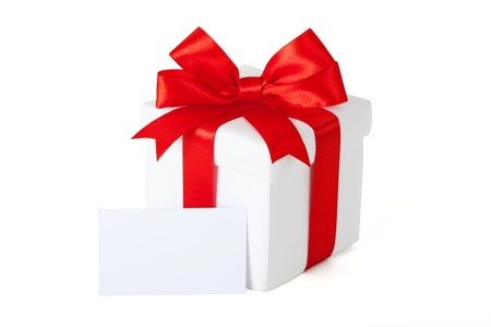 Single gift box with red ribbon and gift card on white background. photo