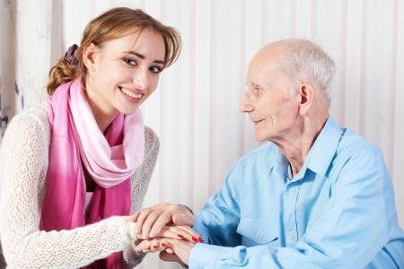 home help: Senior man with her caregiver at home