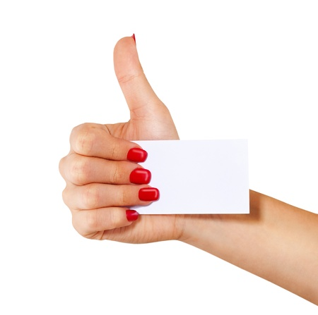 Hand with a business card shows the thumb, isolated on white background  photo
