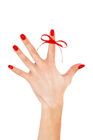 Red bow on finger, isolated on white background Stock Photo - 16295400