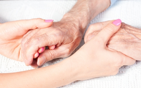 nursing young: a care is at home of elderly Stock Photo