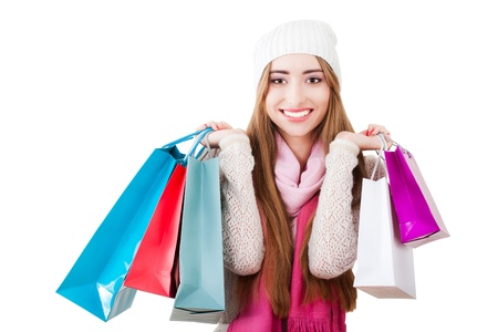 Portrait of a beautiful young woman with shopping bags on a white background close-up. photo