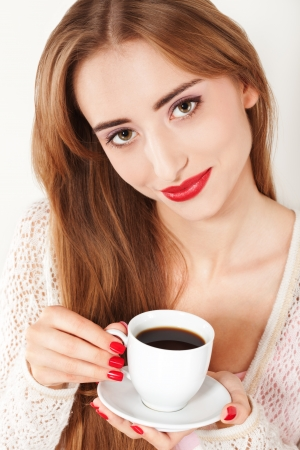 Portrait of Beautiful Woman with cup of Coffee close up photo