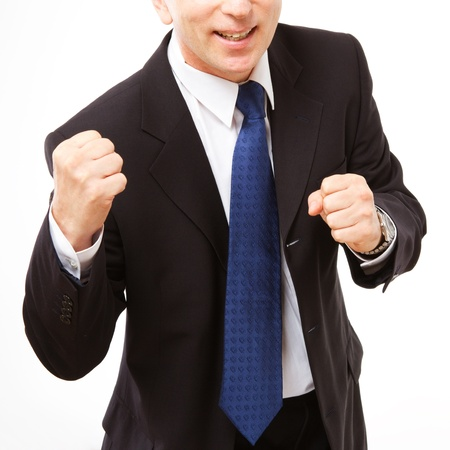 Businessman stands with clenched fists. Close-up on a white background. photo