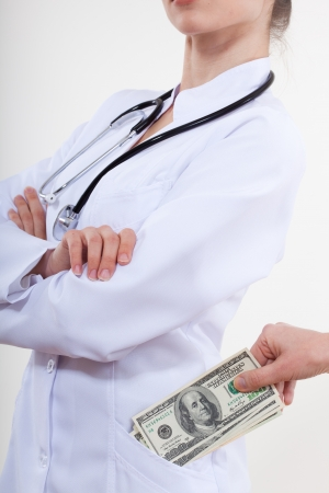 doctor putting money: The patient puts money in your pocket doctor