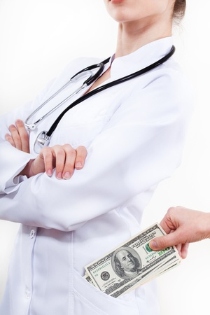 doctor putting money: Patient bribing doctor, putting money to pocket