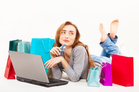 Beautiful young woman shopping over internet Stock Photo