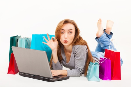 Beautiful young woman shopping over internet Stock Photo - 17694471
