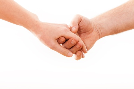 girls holding hands: Holding hands couple on white background