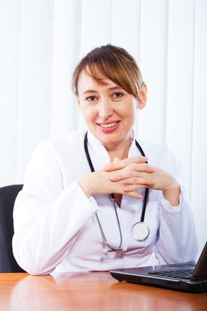 Portrait of happy woman doctor photo