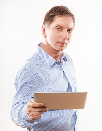Portrait of young man holding  tablet photo