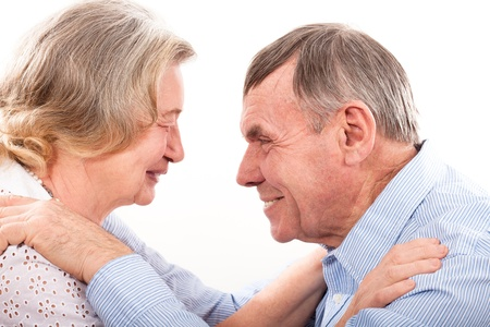 Closeup portrait of smiling elderly couple photo