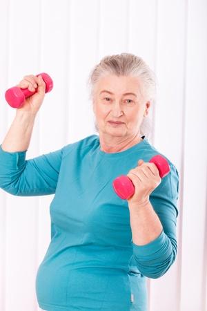 happy senior woman with dumbbells Stock Photo - 18907626