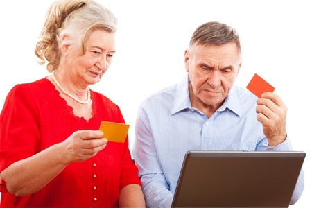 elderly couple doing online shopping  photo