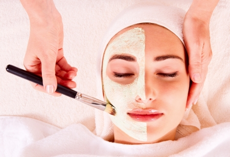 resting mask: Woman receiving facial mask at beauty salon