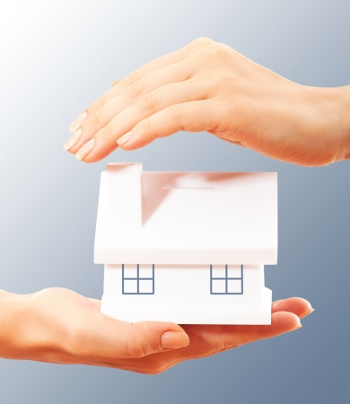 The house in human hands Reklamní fotografie