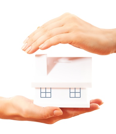 household insurance: The house in human hands Stock Photo