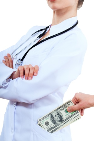 doctor putting money: The patient puts money in your pocket doctor.  Isolated over white background