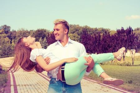 beautiful girl embraces the guy photo