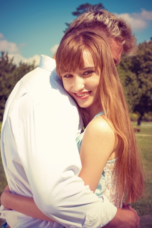 hugs and kisses: beautiful girl embraces the guy