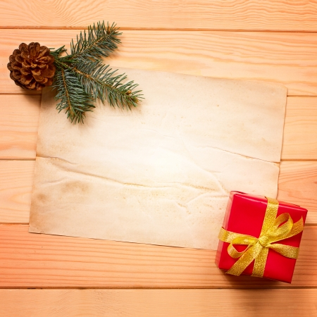 Vintage gift box  package  with blank gift tag on old wooden background  photo
