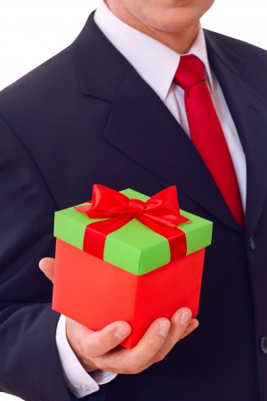 businessman holding  gift box with red bow photo