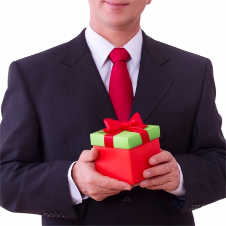 businessman holding  gift box with red bow Stock Photo - 22990713