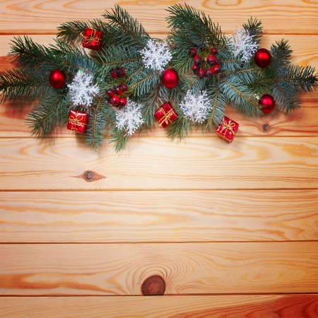 Christmas card. Vintage gift box (package) with blank gift tag on old wooden background. photo