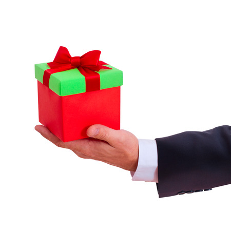businessman holding gift box with red bow isolated photo