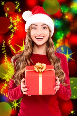 picture of cheerful santa helper girl with gift box photo