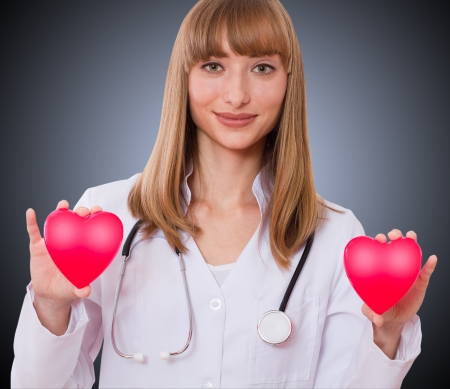 Female doctor holding heart  the concept of health insurance, life insurance photo
