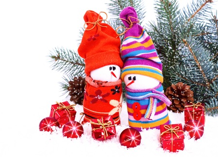 composition with Christmas snowmans and red bauble fir branches isolated on white background photo