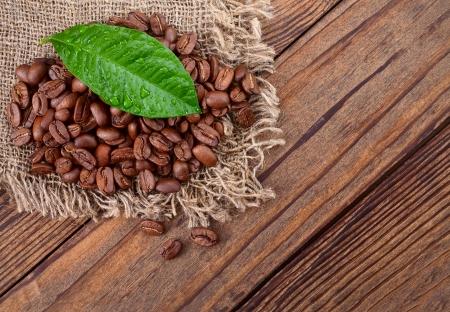 coffee beans on wood texture closeup, macro  photo