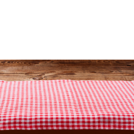 on the tablecloth: Empty wooden deck table with tablecloth on white for product montage