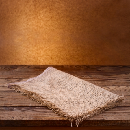 Empty wooden deck table with tablecloth  Free space for your text Stock Photo